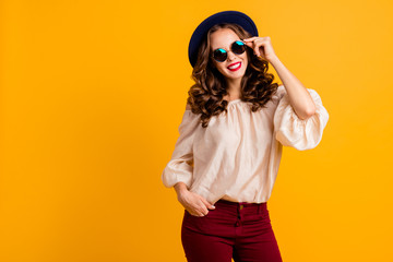 Wall Mural - Portrait of her she nice-looking cool attractive fascinating lovely gorgeous pretty content cheerful cheery wavy-haired lady touching round glasses isolated over bright vivid shine yellow background