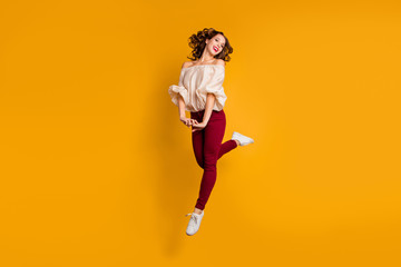 Wall Mural - Full length body size view portrait of her she nice-looking attractive aforable pretty winsome cheerful cheery wavy-haired lady having fun isolated over bright vivid shine yellow background