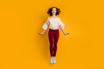 Wall Mural - Full length body size view portrait of her she nice-looking attractive pretty perfect sporty cheerful wavy-haired lady having fun isolated over bright vivid shine yellow background