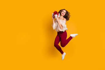 Wall Mural - Full length body size view portrait of nice-looking attractive pretty slim fit thin glad cheerful cheery wavy-haired lady holding in hands box isolated over bright vivid shine yellow background