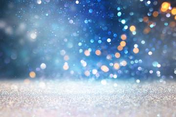 Fototapete - glitter vintage lights background. black silver and blue. de-focused