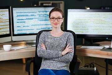 Portrait of female programmer in office at night - fototapety na wymiar