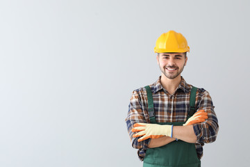 Male worker on light background Wall mural