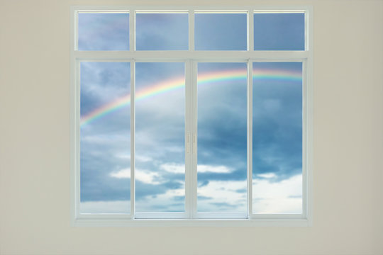 Modern house window view with rainbow background