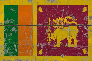 Grunge Sri Lanka flag on old scratched wooden surface. National vintage background.