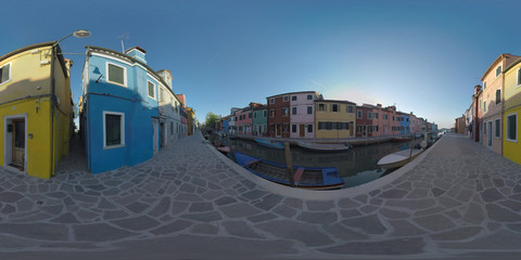 360 photo - Picturesque Burano scene with colourful homes in a row alongside the canal with boats. Quiet street in popular place of interest in Italy
