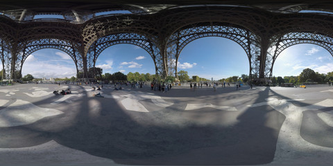 360 photo - Under the Eiffel Tower. People walking and relaxing on ground with mural Endless Sleep depicted there. View to Champ de Mars and Palais de Chaillot