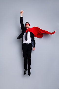 Full length body size photo jumping high he his him I save world expression costume flight up fist raised superman pose mood wear formal wear white shirt suit jacket tie isolated grey background