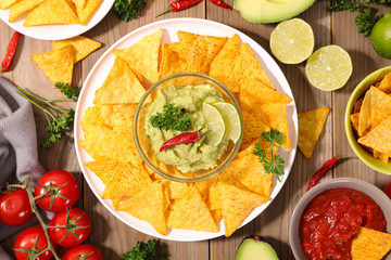tortilla chip with guacamole and salsa sauce