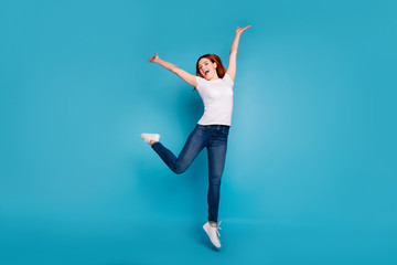 Wall Mural - Full length body size view portrait of her she nice attractive cheerful cheery ecstatic girl wearing white tshirt having fun time free freedom isolated over bright vivid shine blue background