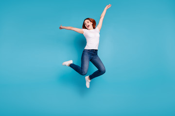 Wall Mural - Full length body size view portrait of her she nice lovely attractive cheerful cheery ecstatic girl wearing white tshirt having fun free freedom isolated over bright vivid shine blue background