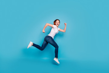 Wall Mural - Full length body size profile side view portrait of her she nice attractive cheerful cheery purposeful girl wearing white tshirt fast speed marathon isolated over bright vivid shine blue background