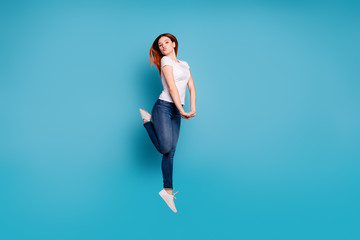 Wall Mural - Full length body size profile side view portrait of nice attractive cheerful cheery girlish funny childish girl in white tshirt having fun isolated on bright vivid shine blue background