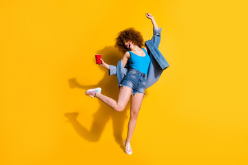 Full length body size photo funny funky she her lady wavy styling curls scream shout yell little drunk hang out wear specs casual jeans denim shirt shorts tank top clothes isolated yellow background