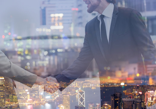 Double exposure of Businessman shaking hands as the trust commitment which Business Partners and factors relationship marketing for reach successful achievement and meeting commit concept