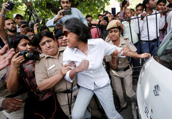 Police officers detain a demonstrator during a protest after a panel of judges dismissed a sexual harassment complaint against Chief Justice of India (CJI) Ranjan Gogoi, outside Supreme Court in New Delhi