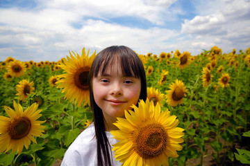 Portrait of smiling girl on sunflower field