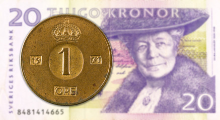 1 swedish oere coin against 20 swedish krona bank note