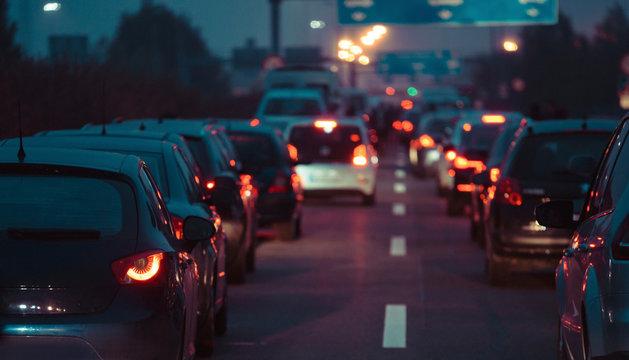 Traffic jam cars in row dusk night