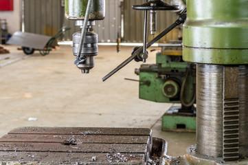 Drilling machine in factory workshop