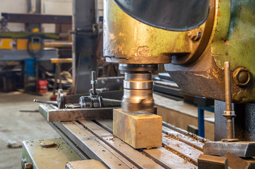 Industrial metalworking cutting process by milling cutter in a factory