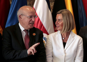 European Union High Representative for Foreign Affairs and Security Policy Federica Mogherini speaks with Portuguese Foreign Minister Augusto Santos Silva during a family picture at the International Contact Group in San Jose