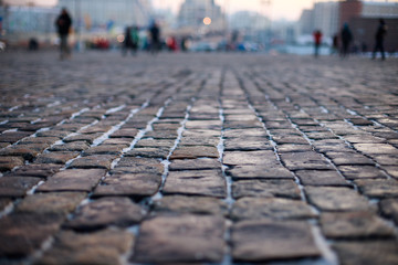 Stone pavement in perspective. Old street paved with stone blocks. Shallow depth of field. Vintage grunge texture. Wall mural