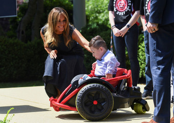 "First lady Melania Trump reaches out to young boy in modified wheelchair attending ""Be Best"" anniversary event at the White House in Washington"