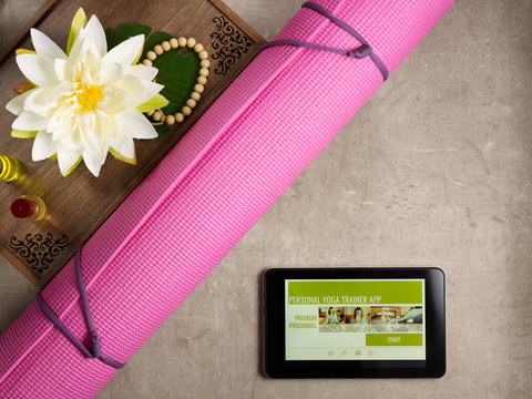 tray with fragrant stuff for yoga and tablet PC with trainer app