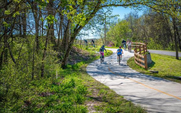 Family with kids biking on bike trail in Bella Vista, Northwest Arkansas