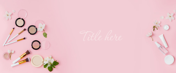 Banner with Face care and make up products with spring apple bloom (tonic or lotion, serum, cream, micellar water, cotton pads and makeup brushes) on pink background. Freshness and face care Wall mural