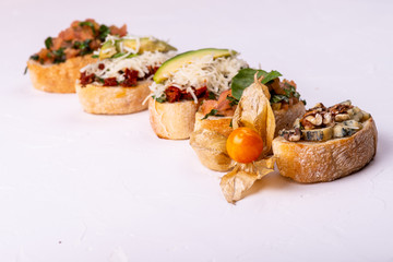 Delicious Italian antipasti bruschetta on white background. Macro.