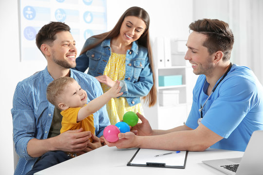 Family with child visiting doctor in hospital