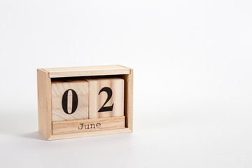 Wooden calendar June 02 on a white background
