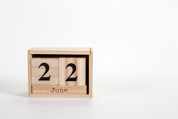 Wooden calendar June 22 on a white background