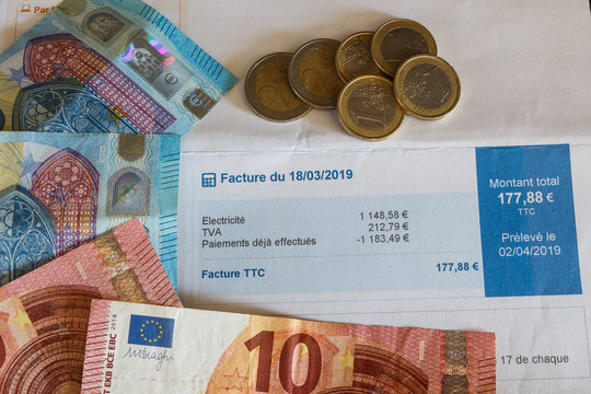 French electricity invoice, euro coins and notes