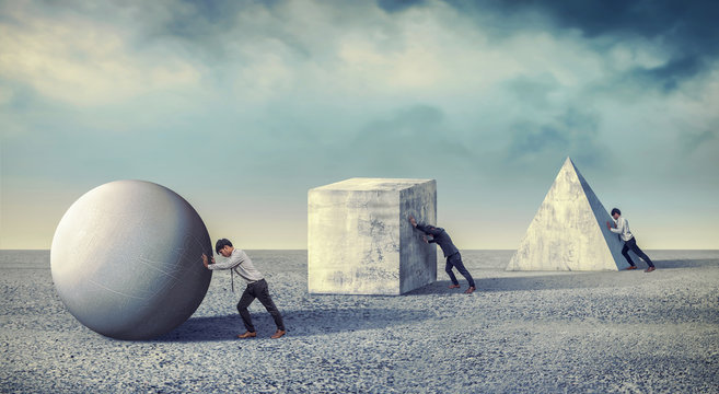 Businessman pushing the round large stone. Business heavy tasks and problems concept. differentiation between work
