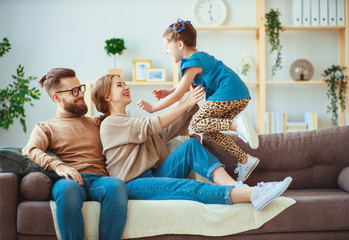 happy family mother father and child daughter laughing   at home  .