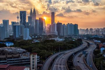 Fototapete - Sunset over Kuala Lumpur city in Malaysia
