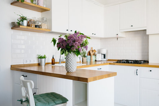 Modern white kitchen in scandinavian style.