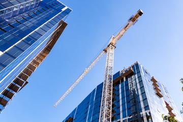 Fototapeta Crane and skyscrapers under construction in San Jose, South San Francisco bay area obraz