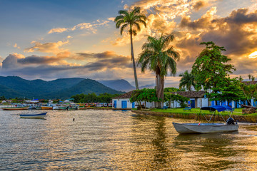 Wall Mural - Embankment of historical center in Paraty at sunset, Rio de Janeiro, Brazil. Paraty is a preserved Portuguese colonial and Brazilian Imperial municipality