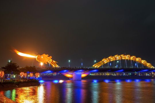 Dragon bridge in Da Nang, Vietnam, at night. The dragon blowing hot fire out of its mouth. A famous attraction in Da Nang.