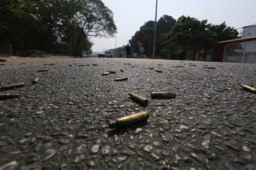 Bullet casings lie on the street near a crime scene in Acapulco, Mexico