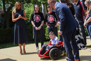 "First lady Melania Trump watches young boy in modified wheelchair attending ""Be Best"" anniversary event at the White House in Washington"