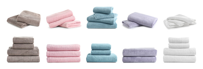 Set of folded soft terry towels on white background