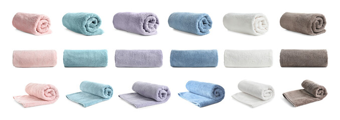 Set of different clean terry towels on white background