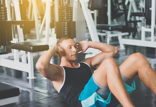 Man doing situp or crunches in gym,Men exercise muscular stomach