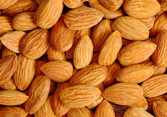Many almond nuts as background or texture