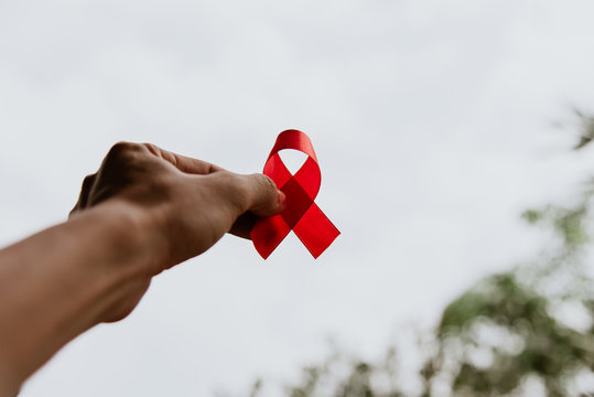 Red ribbon for world aids day awareness campaign background.